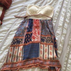 Strapless mini dress w/ belt.